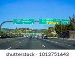 freeway interchange sign in... | Shutterstock . vector #1013751643