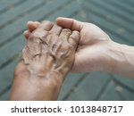 Small photo of Ageing society (elderly care) or Mother Day or International Women Day concept with mother's hand in daughter's hand holding. (close up, selective focus)