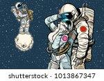 cosmonauts are dancing.... | Shutterstock .eps vector #1013867347