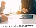 analyzing with tablet pc at... | Shutterstock . vector #1013877073