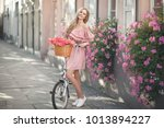 pretty young woman is riding on ...   Shutterstock . vector #1013894227
