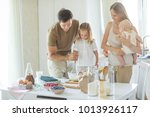 the family cooks in the kitchen  | Shutterstock . vector #1013926117
