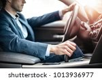 businessman driving a sportive... | Shutterstock . vector #1013936977