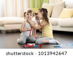 two happy children  cute... | Shutterstock . vector #1013942647