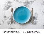 blue round plate with utensils... | Shutterstock . vector #1013953933