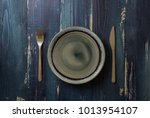 round plate with utensils on... | Shutterstock . vector #1013954107
