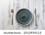 round plate with utensils on... | Shutterstock . vector #1013954113