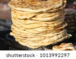 pita. pile of roasted pita ... | Shutterstock . vector #1013992297