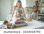the family cooks in the kitchen  | Shutterstock . vector #1014018793