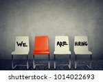 Stock photo row of chairs saying we are hiring offering vacant places 1014022693