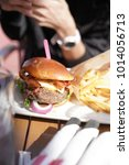 closeup of hamburger and french ... | Shutterstock . vector #1014056713
