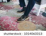 man in modern leather shoes and ... | Shutterstock . vector #1014063313