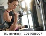 athletic girl in fitness room...   Shutterstock . vector #1014085027