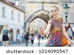 a young smiling woman tourist... | Shutterstock . vector #1014090547