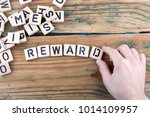 reward. wooden letters on the... | Shutterstock . vector #1014109957