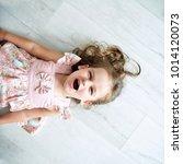 sweet little girl is lying on...   Shutterstock . vector #1014120073