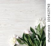 white peony flowers on  wooden...   Shutterstock . vector #1014125743