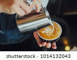 barista make coffee latte art... | Shutterstock . vector #1014132043