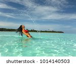 young pretty woman in bikini... | Shutterstock . vector #1014140503