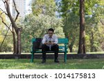 business man sit check email on ... | Shutterstock . vector #1014175813