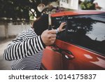 thieves used a hammer to smash... | Shutterstock . vector #1014175837