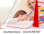 mother and daughter studying... | Shutterstock . vector #1014198787