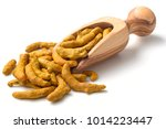 Stock photo dried turmeric root in the olive wood scoop isolated on white 1014223447