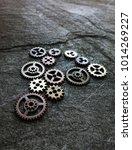 assorted metal gears on grunge... | Shutterstock . vector #1014269227