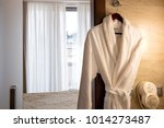 terry robe on  hanger in... | Shutterstock . vector #1014273487