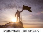 silhouette of man with flag of... | Shutterstock . vector #1014347377
