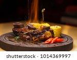 restaurant dish. fried ribs of... | Shutterstock . vector #1014369997