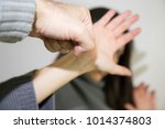 woman covering her face in fear ... | Shutterstock . vector #1014374803