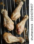 bbq chicken legs roasted on the ... | Shutterstock . vector #1014378457