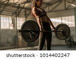 determined and strong fitness... | Shutterstock . vector #1014402247