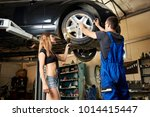 mechanic and a young girl are... | Shutterstock . vector #1014415447