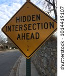 Small photo of Hidden Intersection Ahead Sign