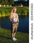beautiful blonde woman wearing... | Shutterstock . vector #1014451063