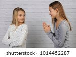 girl apologizing to her friend... | Shutterstock . vector #1014452287