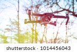 drone flying in the blue sky ... | Shutterstock . vector #1014456043