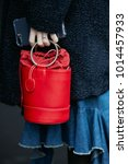 Small photo of MILAN - JANUARY 15: Woman with red Gazel bag and blue fur coat before Pal Zileri fashion show, Milan Fashion Week street style on January 15, 2018 in Milan.