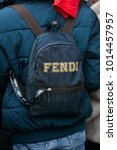 Small photo of MILAN - JANUARY 15: Man with Fendi backpack before Pal Zileri fashion show, Milan Fashion Week street style on January 15, 2018 in Milan.