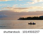 Two Fishermen In A Boat Going...