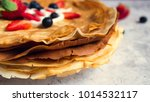 stack of thin pancakes poured... | Shutterstock . vector #1014532117