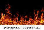 fire flames on black background. | Shutterstock . vector #1014567163