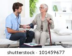 young man taking the blood... | Shutterstock . vector #101459677
