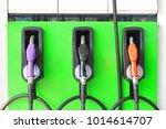 row of fuel nozzle refill pump... | Shutterstock . vector #1014614707
