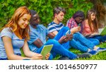 group of multi ethnic teenagers ... | Shutterstock . vector #1014650977