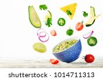 guacamole with flying corn... | Shutterstock . vector #1014711313