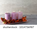 Three Burning Candles On Stand...