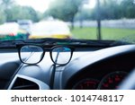 eyewear placed on the car... | Shutterstock . vector #1014748117